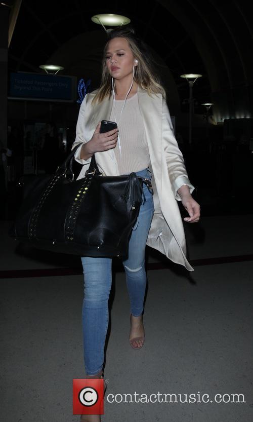 Chrissy Teigen at Los Angeles International Airport
