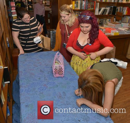 Author Maggie Stiefvater greets fans and signs copies...