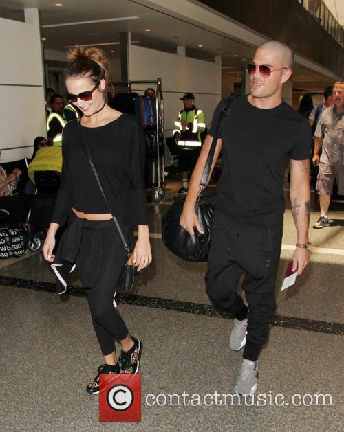 Max George and his girlfriend Carrie Baker depart...
