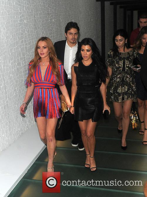 Kourtney Kardashian and Lindsay Lohan party together