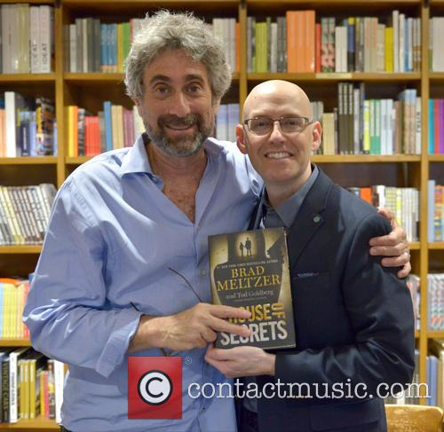 Author Brad Meltzer signs copies of his new...