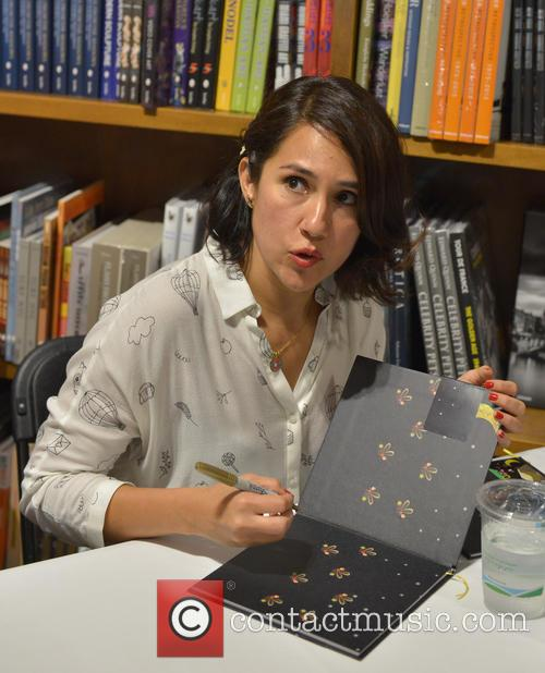 Luz Ortiz signs copies of her book 'Luzia'
