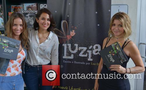 Luz Ortiz signs copies of her book 'Luzia'