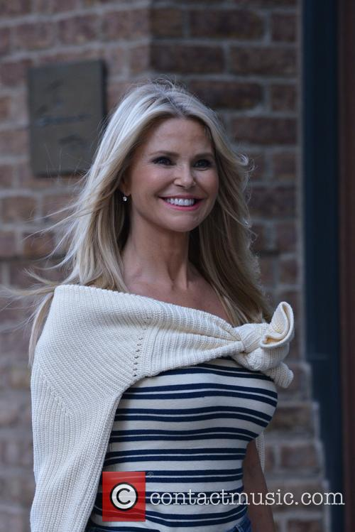 Christie Brinkley poses for photographers
