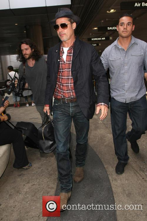 Brad Pitt arrives at Los Angeles International (LAX)...