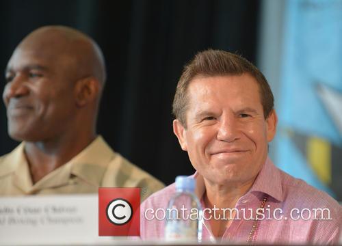 Evander Holyfield and Julio César Chávez 6