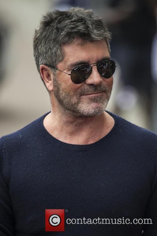 Simon Cowell Feared He Had Broken His Neck After Falling Down Stairs