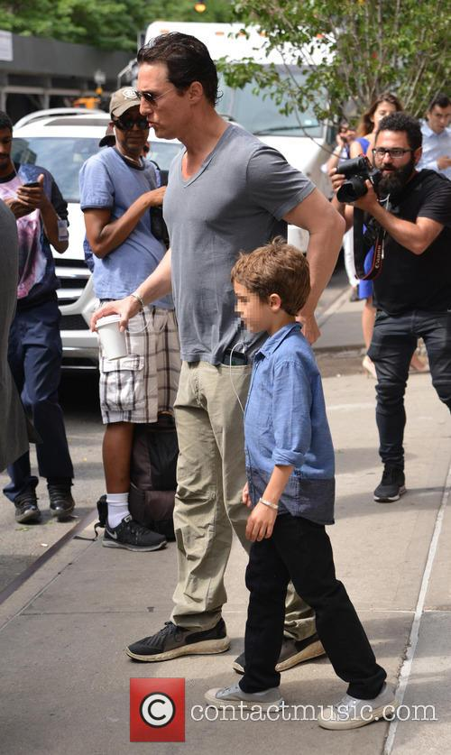Matthew McConaughey leaves the hotel with his son