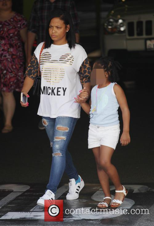 A make up free Christina Milian takes her...