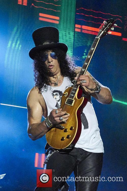 Slash with Guns N' Roses performing live