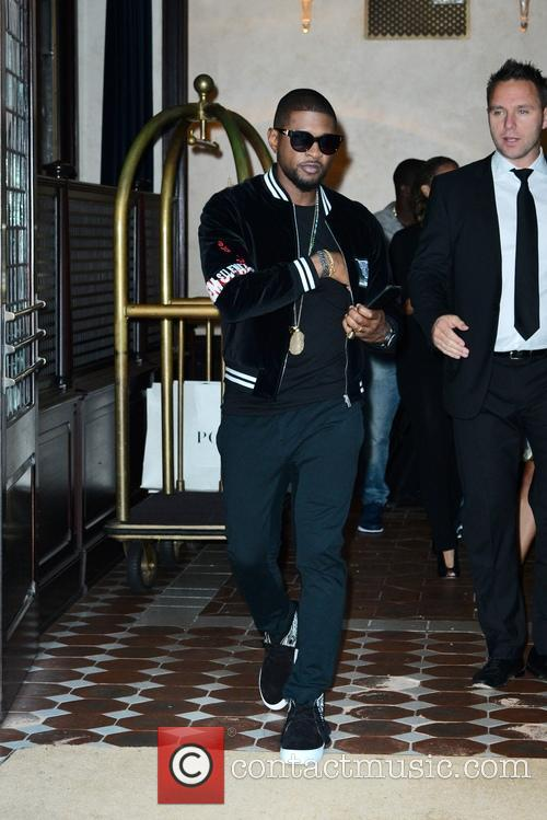 Usher leaving his hotel in New York
