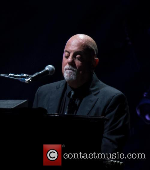 Billy Joel performing at Wembley