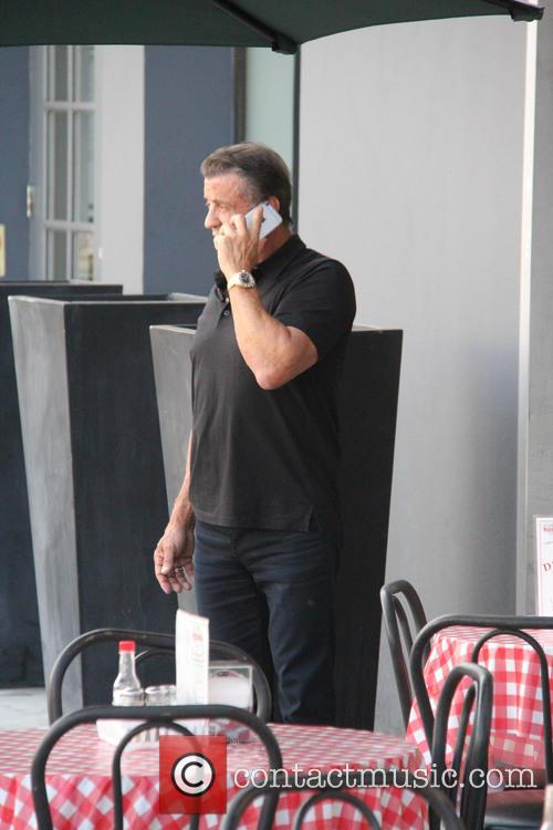 Sylvester Stallone talks on his phone outside Mulberry...