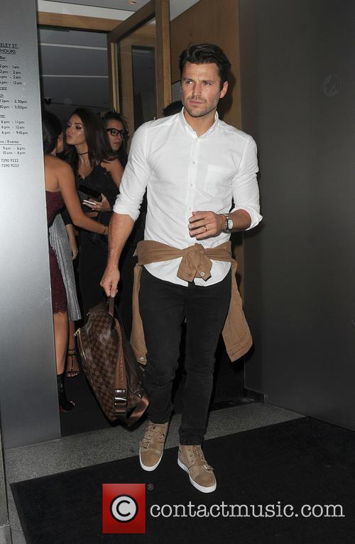 Mark Wright and his wife Michelle Keegan leaving...