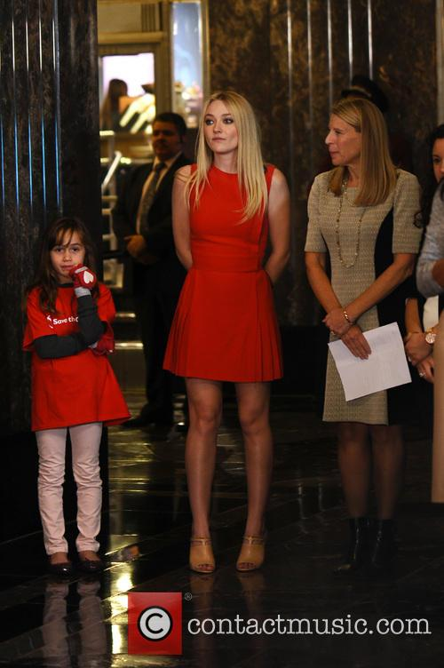 Dakota Fanning Lights The Empire State Building