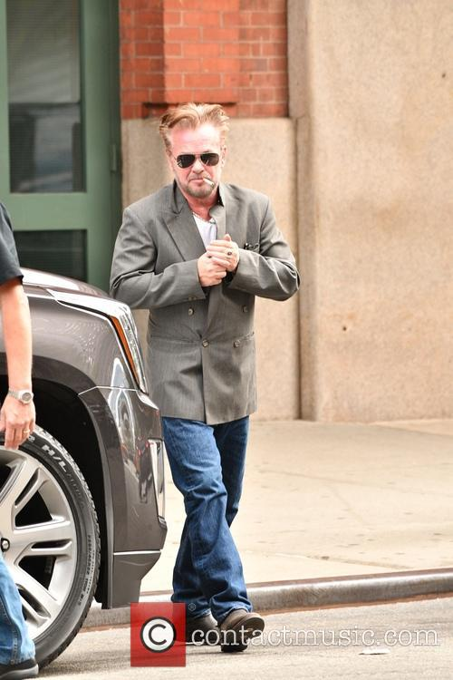 John Mellencamp leaving his hotel in New York