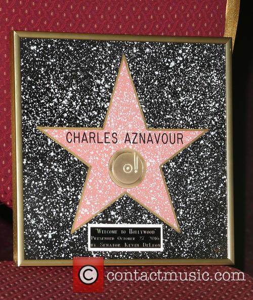 Charles Aznavour receives an honorary Hollywood Star plaque