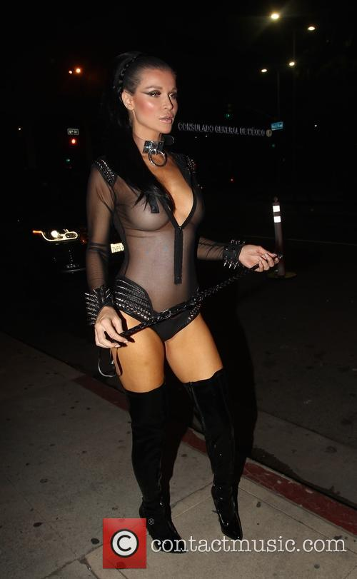 Joanna Krupa wears a sexy dominatrix outfit as...