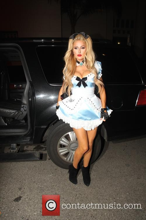 Paris Hilton arrives for the Hollywood Magazine party...