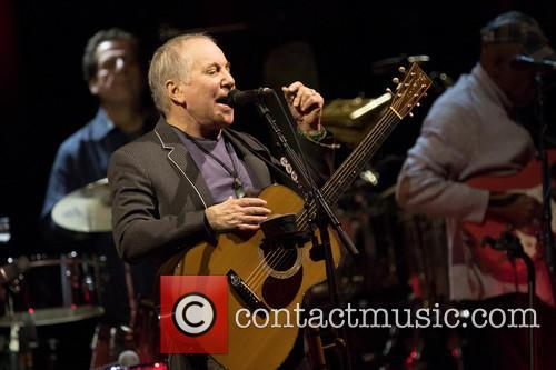 Paul Simon performing live