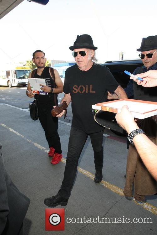 Daryl Hannah and Neil Young depart from LAX