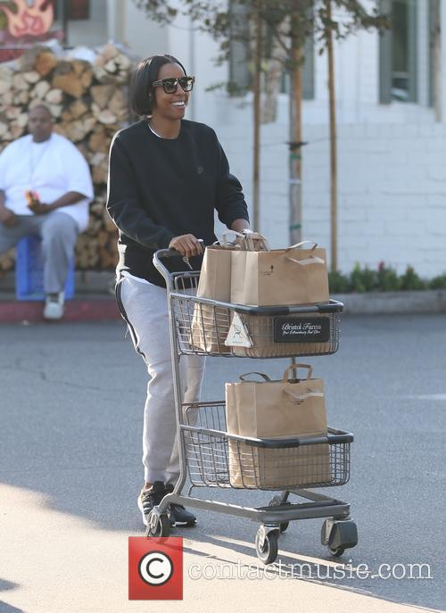 A causal looking Kelly Rowland goes shopping at...