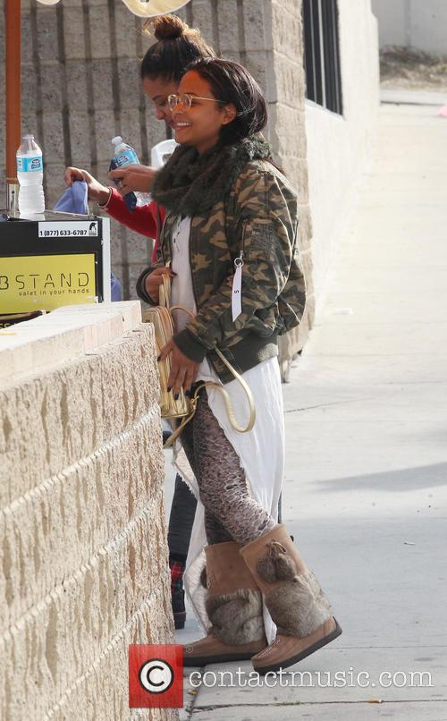 Christina Milian stops by a gas station to...