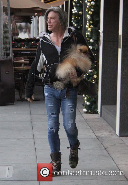 Mickey Rourke leaves Caffe Roma carrying his pet...