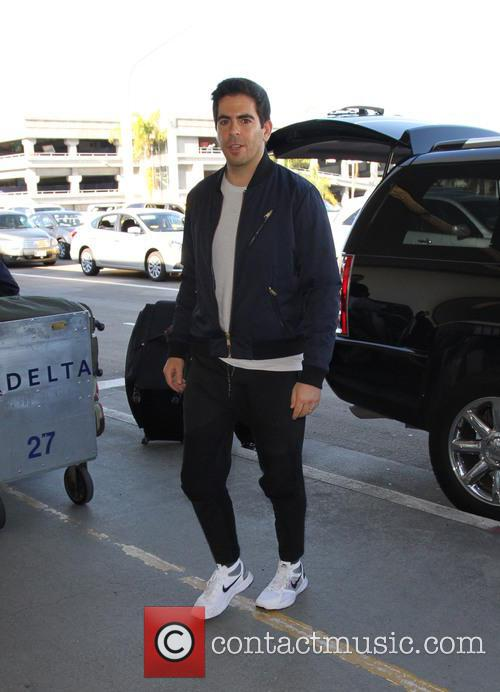 Eli Roth and his wife arrive at LAX