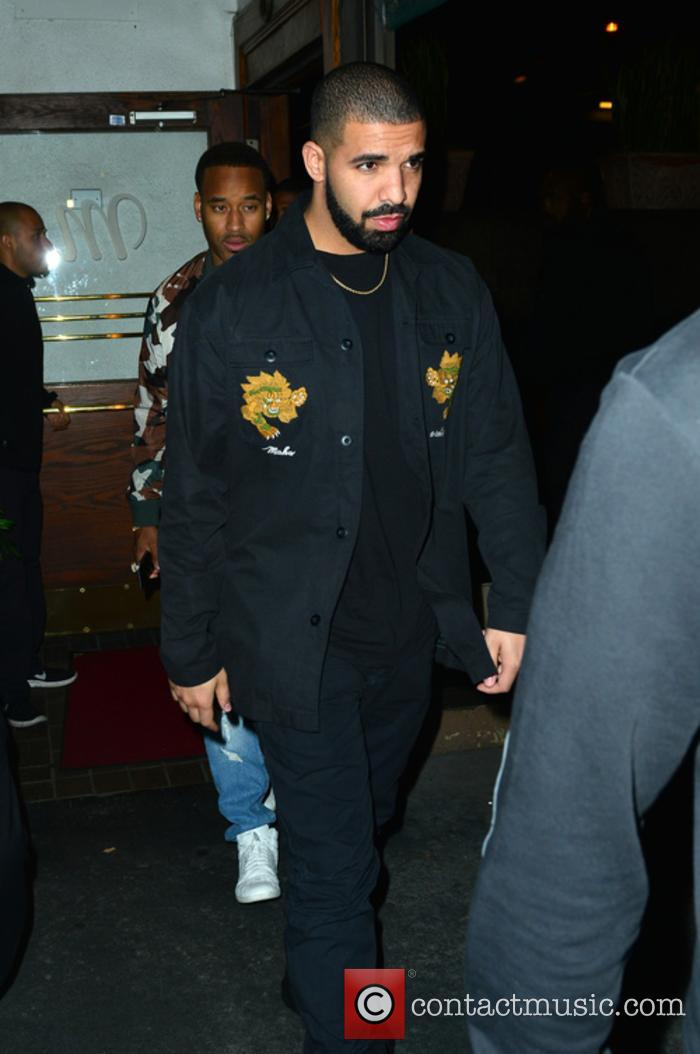 Drake out at Italian restaurant Madeo in Beverly...