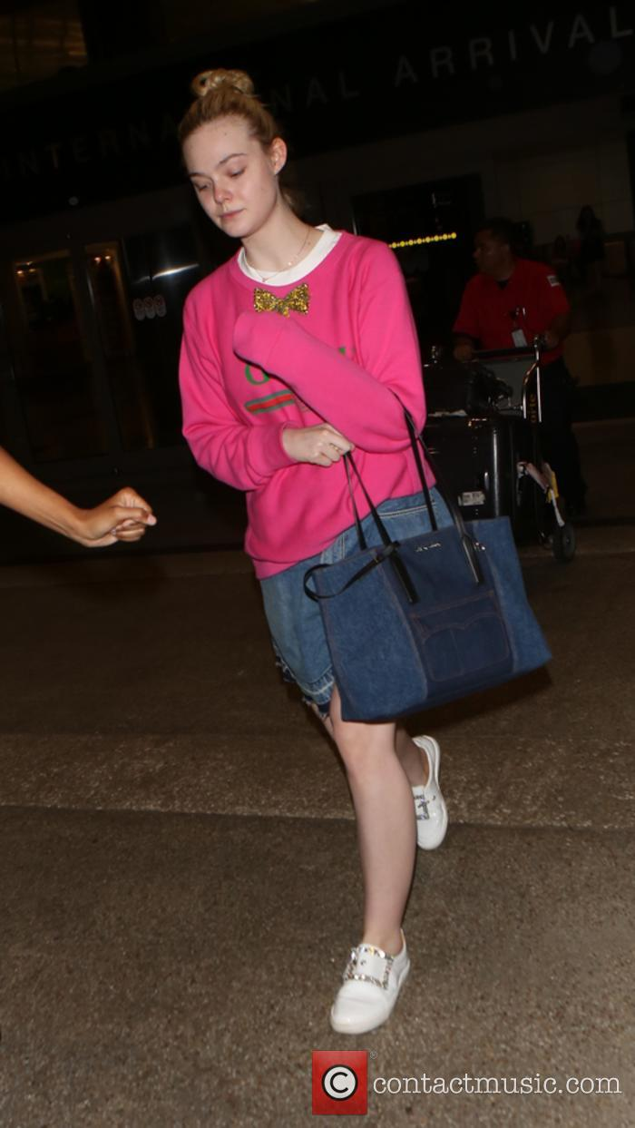 A make up free Elle Fanning arrives at...