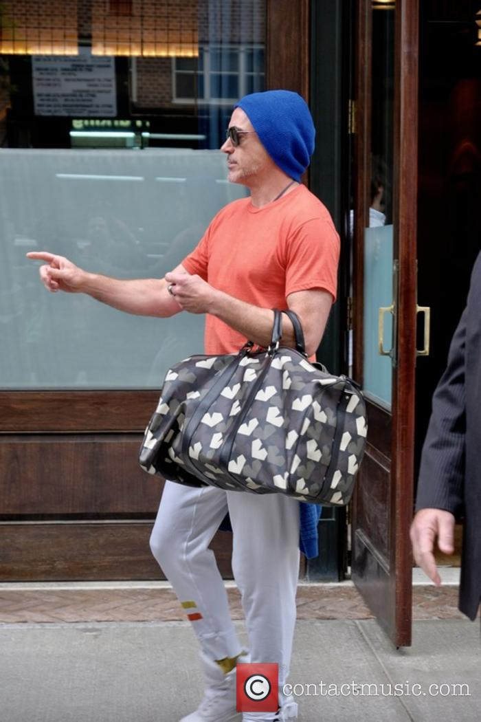 Robert Downey Jr. leaving his hotel in New...