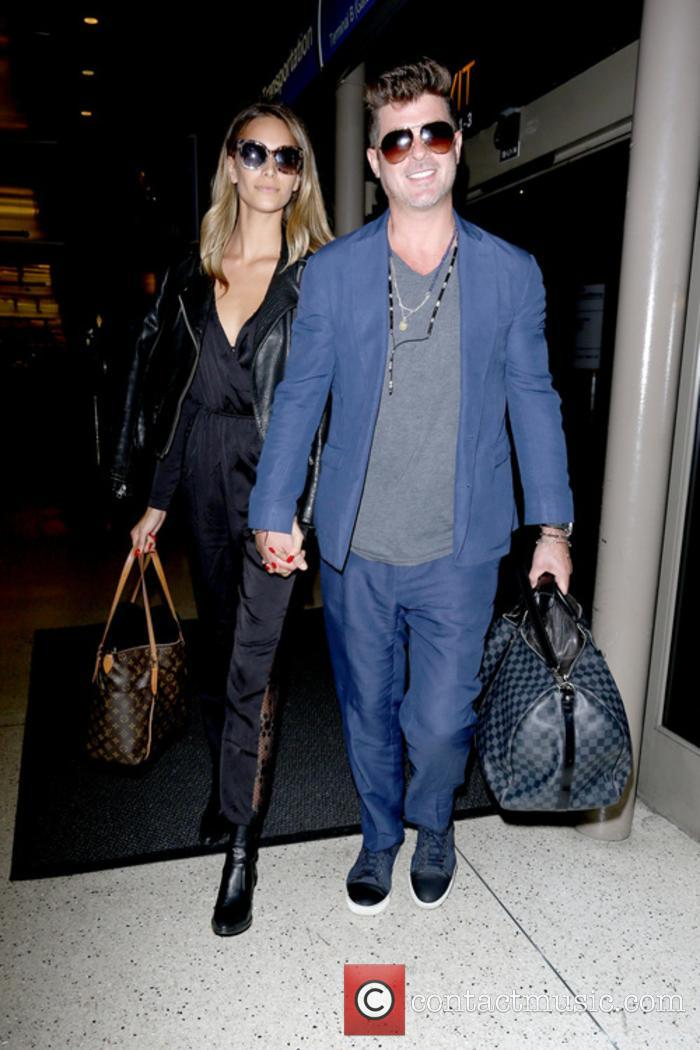 Robin Thicke and April Love Geary snapped at LAX