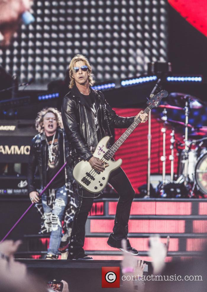 Guns N' Roses performing live in concert