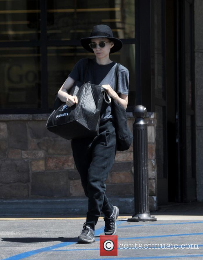 Rooney Mara disguises herself with sunglasses and a...