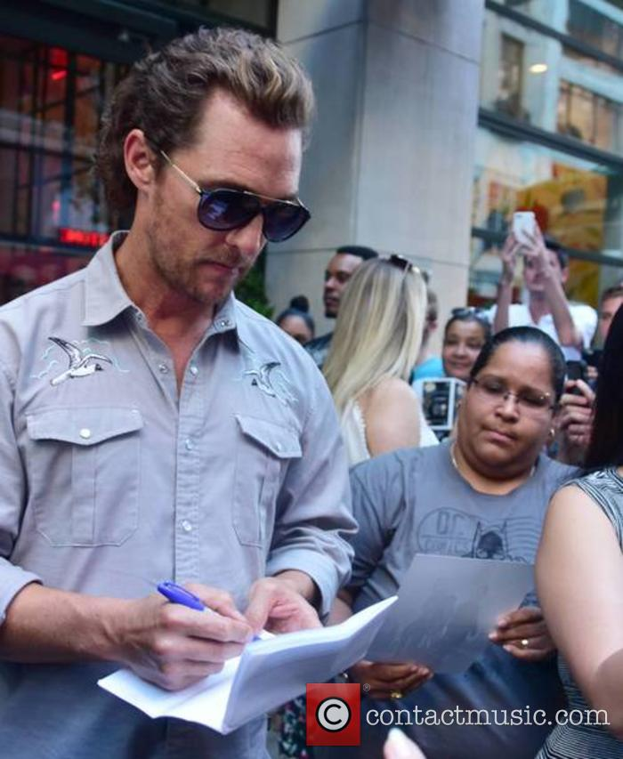 Matthew McConaughey signs autographs for fans as he...