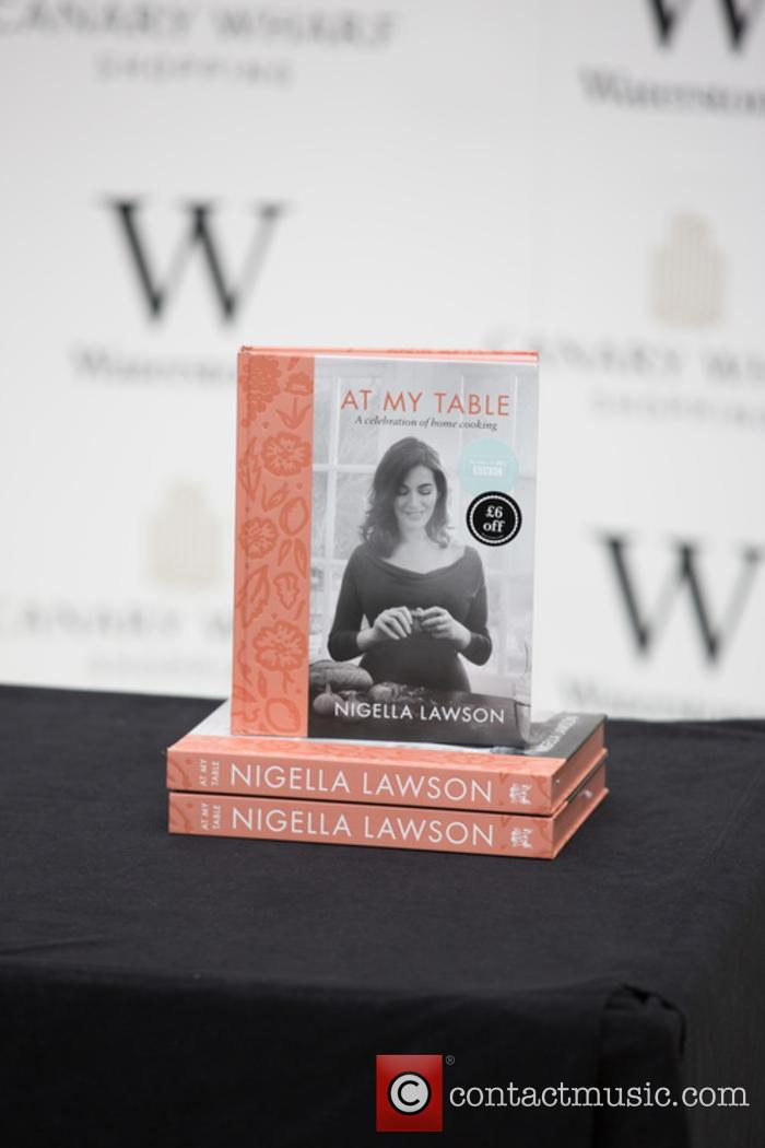 Nigella Lawson signs copies of her latest cookery...