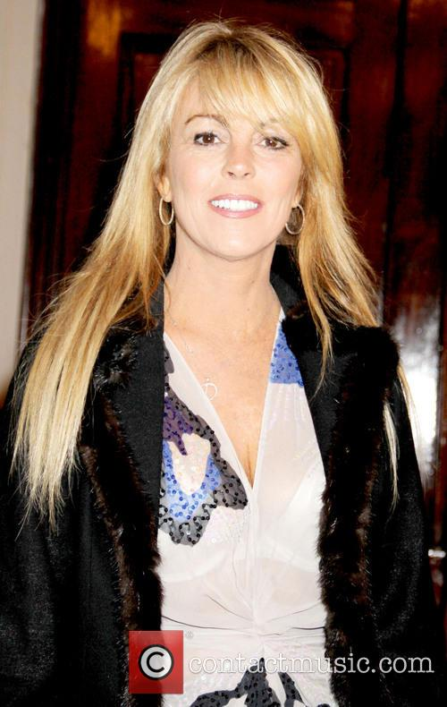 Dina Lohan, wearing clothes from her daughter's clothing...