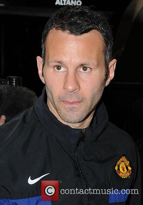 File Photo Manchester United midfielder, Ryan Giggs, turns...