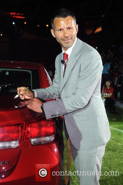 File Photo Manchester United midfielder, Ryan Giggs, turns...
