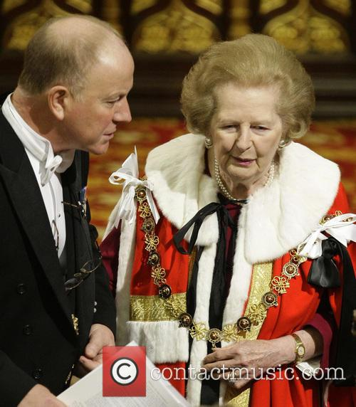 Baroness Margaret Thatcher is helped to her seat...