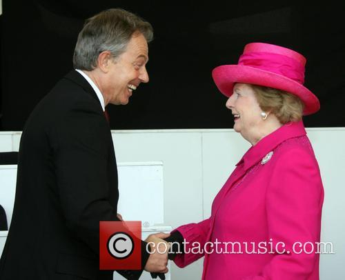 Prime Minister Tony Blair shakes hands with Baroness...