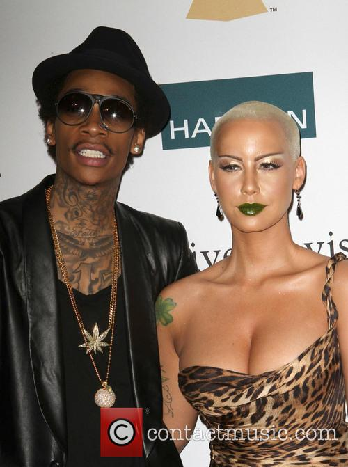 WIZ KHALIFA AND AMBER ROSE WED Rapper WIZ...
