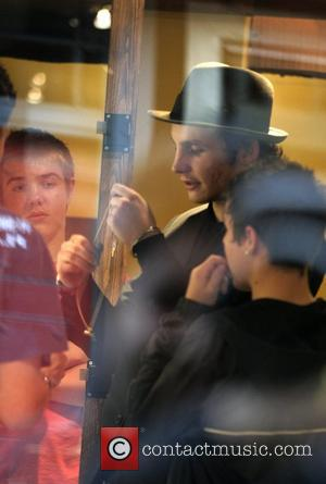 Blake Fielder storms out of a Covent Garden Hotel not looking happy and with his face covered with scratches. After...