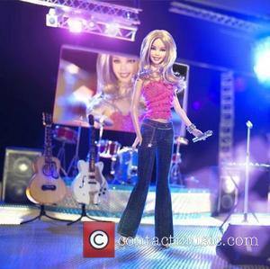 WENN PICTURE CAPTION 17 MARCH 2005 ---------------------------------------------------------------------- RIMES IS A LIVING DOLL ---------------------------------------------------------------------- Country star LEANN RIMES is a real...