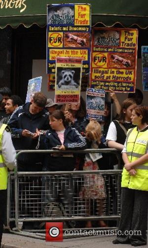 Animal rights portesters demonstrating against the sale of fur at Harrods The 2007 Harrods Summer Sale London, England - 02.07.07