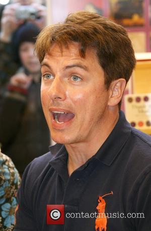 John Barrowman signs copies of the book 'Anything Goes' he wrote with his sister Carole Barrowman at Borders Bookstore Cardiff,...