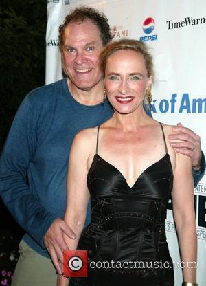 Jay O Sanders and Laila Robins