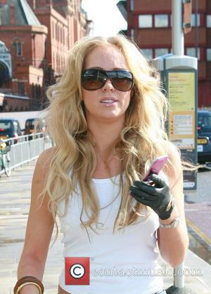 Aisleyne Horgan Wallace waits for her car to pick her up after arriving at Kings Cross St. Pancreas from France....