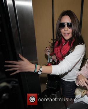 Amanda Bynes leaving the Jessica Galvan Hair Studio in Beverly Hills with her dog where she got her hair newly...